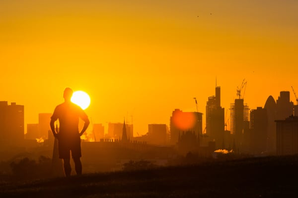 London: Walkers on Primrose hill are silhouetted against the rising sun as the day breaks over London's skyline on October 27, 2017 in London, England.