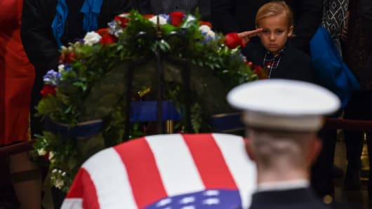 Stephen G. Leighton Jr. salutes as he pays his respects to former US President George H. W. Bush as he lies in state in the US Capitol's rotunda December 3, 2018 in Washington, DC.