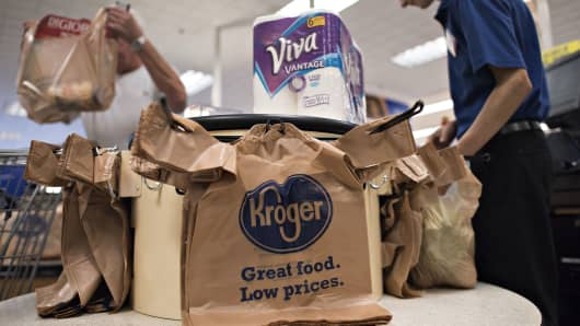 An employee bags a customer's purchases at a Kroger Co. store in Peoria, Illinois.