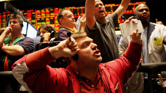 Traders signal offers in the Ten-Year Treasury Note Options pit at the Chicago Board of Trade.