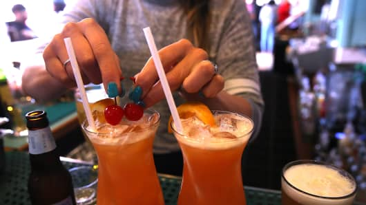 A bartender at Wipeout Bar & Grill makes cocktails that have paper straws on June 21, 2018 in San Francisco, California.