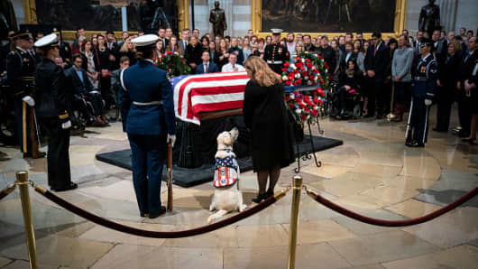 Sully, a yellow Labrador service dog for former President George H. W. Bush, sits near the casket of the late former President George H.W. Bush as he lies in state at the U.S. Capitol, December 4, 2018 in Washington, DC.