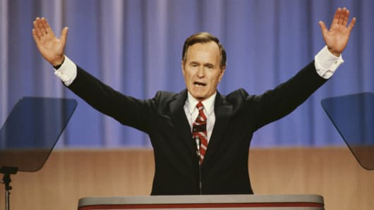 Vice President George Bush raises his arms during a speech at the 1988 Republican National Convention in New Orleans, Louisiana.