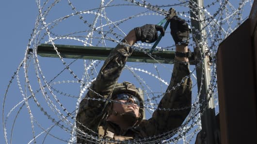 A U.S. Marine secures concertina wire on the California-Mexico border at the Otay Mesa Port of Entry in California, Nov. 23, 2018.