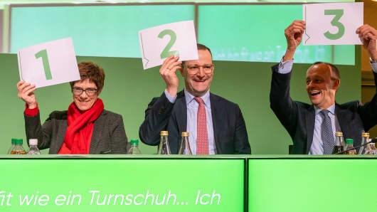 Annegret Kramp-Karrenbauer (L), Jens Spahn (C) and Friedrich Merz (R) of the German Christian Democrats (CDU) attend at a CDU Saxony state congress on December 1, 2018 in Leipzig, Germany. The three are candidates to succeed Angela Merkel as leader of the CDU and are currently campaigning across Germany ahead of the CDU party congress on December 7-8.
