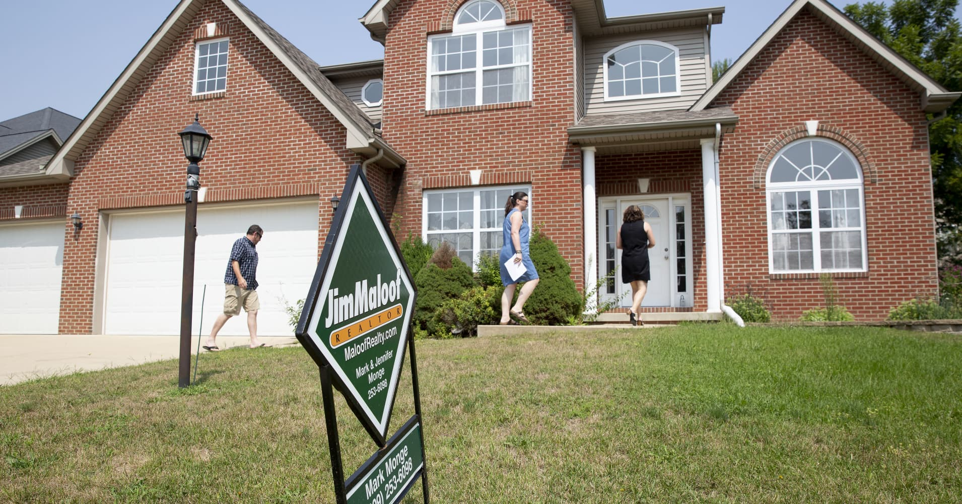 Americans are starting to feel better about buying homes — sort of