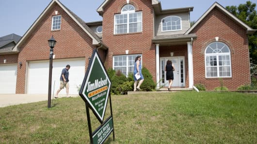 Prospective home buyers arrive with a realtor to a house for sale in Dunlap, Illinois, U.S., on Sunday, Aug. 19, 2018.
