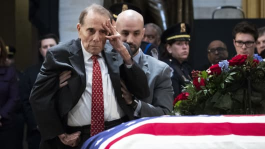 Former Sen. Bob Dole salutes the casket of former President George H.W. Bush, U.S. Capitol, December 4, 2018 in Washington, DC.