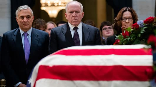 Former Directors of the CIA George Tenet, John Brennan, and current CIA Director Gina Haspel pay their respects at the casket of the late former President George H.W. Bush as he lies in state at the U.S. Capitol, December 4, 2018. Bush had headed the agency.