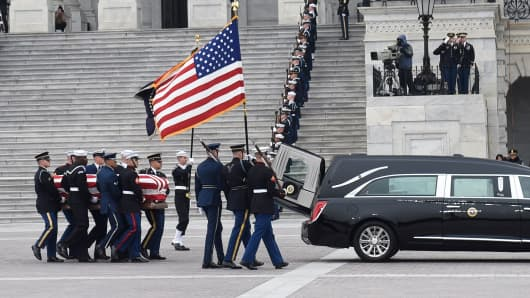 The casket with the remains of former US President George H.W. Bush departs the US Capitol during a State Funeral in Washington, DC, December 5, 2018.