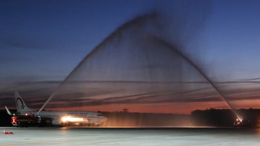 Fire engines give a water salute to welcome the Royal Air Maroc airliner carrying Morocco's national football team as it arrives at the Voronezh Airport for the upcoming FIFA World Cup Russia 2018.