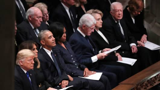 President Donald Trump and first lady Melania Trump sit with former President Barack Obama in the first row along with former first lady Michelle Obama, former President Bill Clinton and former first lady Hillary Clinton, former President Jimmy Carter and first lady Rosalynn Carter prior to the state funeral for former U.S. President George H.W. Bush at the Washington National Cathedral in Washington, U.S., December 5, 2018.