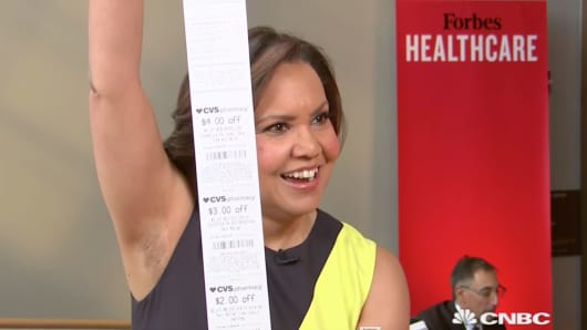 Bertha Coombs asks CVS Health CEO Larry Merlo why the pharmacy chain still prints out long rolls of coupons.