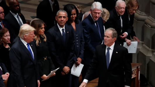 President George W. Bush walks past U.S. President Donald Trump, first lady Melania Trump, former President Barack Obama, former first lady Michelle Obama, former President Bill Clinton, former first lady Hillary Clinton, former President Jimmy Carter and former first lady Rosalynn Carter as he arrives at the state funeral for his father former U.S. President George H.W. Bush at the Washington National Cathedral.