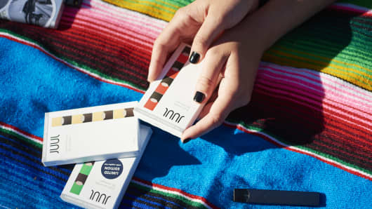 A Juul Labs e-cigarette and flavored pods are arranged for a photograph in Brooklyn, New York.