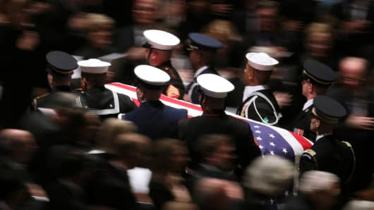 A military honor guard carries the casket out of Washington's National Cathedral after the state funeral for former President George H.W. Bush.