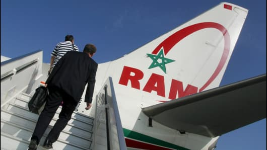 Passengers board a Royal Air Maroc plane.