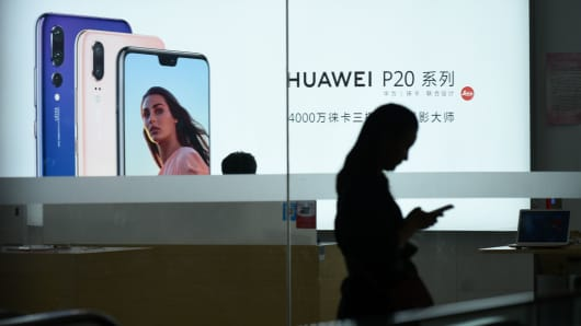 The Huawei poster is displayed in a store in Beijing on August 7, 2018.