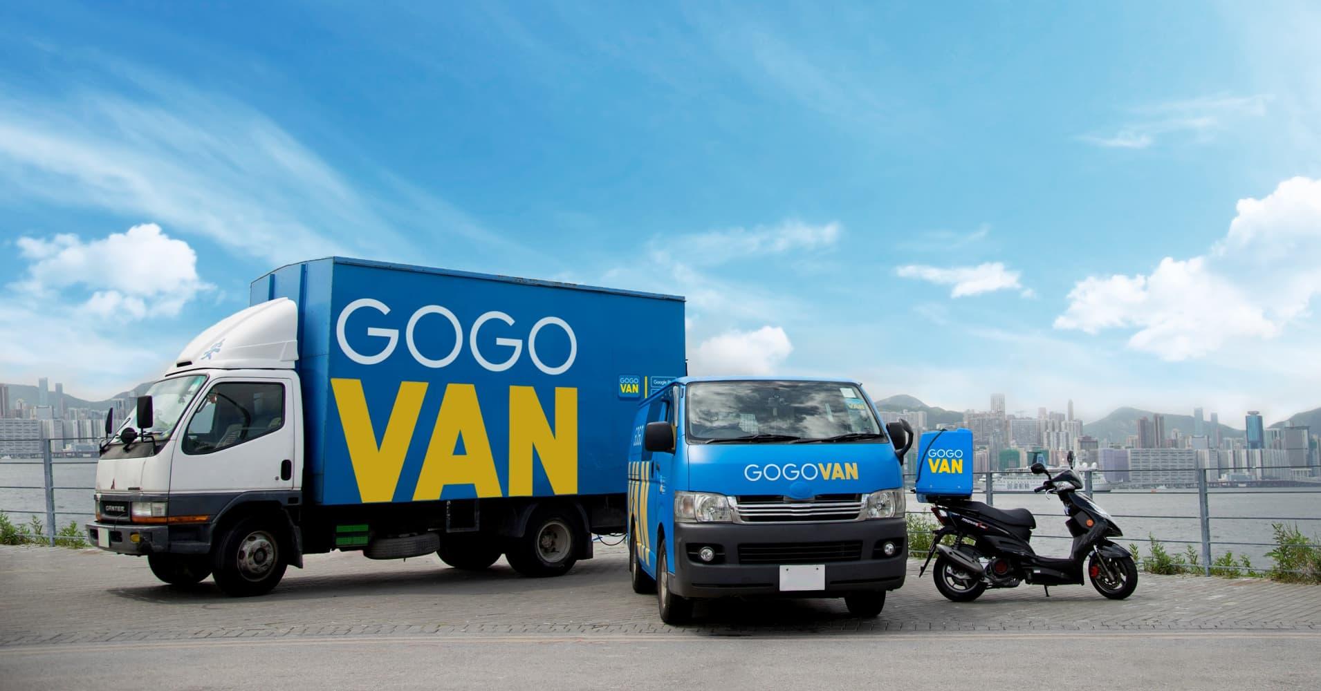 A promotional shot of GoGoVan's fleet set against the Hong Kong skyline.