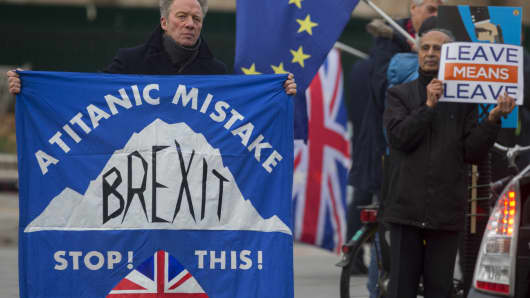 Both pro-EU Remainers and Brexiteers protest their ideals outside the House of Commons, on 4th December 2018, in London, England.