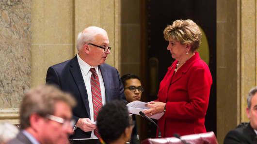 Wisconsin Senate Majority Leader Sen. Scott Fitzgerald (R-Juneau), (L), and Senate Minority Leader Jennifer Shilling (D-La Crosse) confer during a contentious legislative session on December 4, 2018 in Madison, Wisconsin.