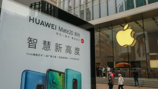 View of a Huawei advert outside an Apple Store in Shanghai, China.