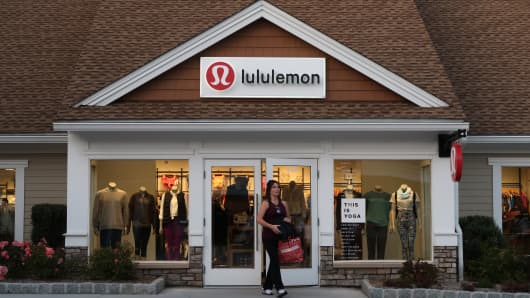 A woman leaves the Lulilemon store at the Woodbury Common Premium Outlets Mall in Central Valley, NY.