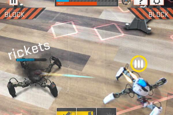 Reach Robotics' MekaMon robots are seen doing battle in an app using augmented reality.