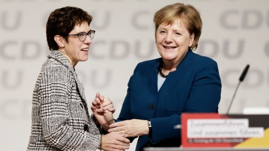 Annegret Kramp-Karrenbauer, left, is congratulated by Angela Merkel after receiving the most votes to become the next leader of the German Christian Democrats (CDU) at a federal congress of the CDU on December 7, 2018 in Hamburg, Germany.