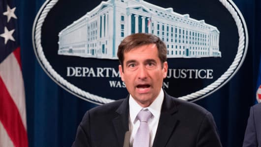 Assistant Attorney General for National Security John Demers (C) speaks after Attorney General Jeff Sessions announced the creation of a new initiative to crack down on Chinese intelligence officials pilfering intellectual property from U.S. corporations through hacking and espionage during a press conference at the Justice Department in Washington, DC, on November 1, 2018. -