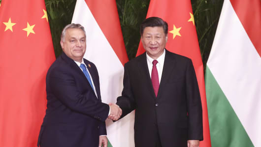 Chinese President Xi Jinping (R) shakes hands with Hungarian Prime Minister Viktor Orban on the sidelines of the China International Import Expo (CIIE) on November 5, 2018 in Shanghai, China.