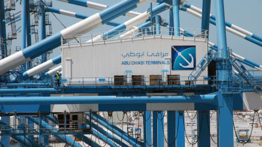 Abu Dhabi Terminals branding is seen on the side of an office atop a ship-to-shore gantry crane at Khalifa Port, operated by Abu Dhabi Ports Co.