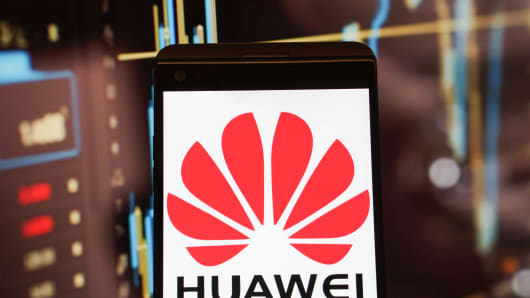 The logo of Huawei is seen on a smartphone.