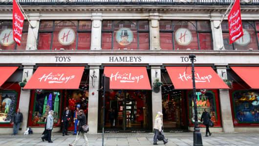 Pedestrians pass the Hamleys toy store on Regent Street in London.
