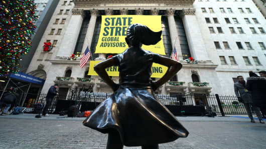 The  Fearless Girl statue is unveiled at her new home facing the New York Stock Exchange (NYSE) during an event on December 10, 2018 held by the city of New York and State Street Global Advisors.