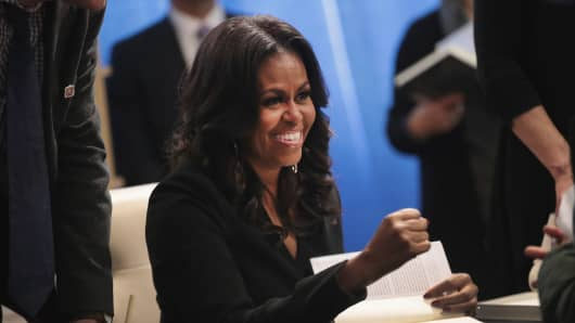 """Former first lady Michelle Obama kicks off her """"Becoming"""" book tour with a signing at the Seminary Co-op bookstore on November 13, 2018 in Chicago, Illinois. I"""