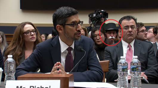 "A person dressed up as the character from the game ""Monopoly"" sat a few rows behind Google CEO Sundar Pichai as he testified in front of a congressional committee on Dec. 11, 2018."