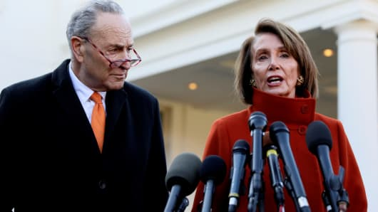 Senate Minority Leader Chuck Schumer (D-NY) and House Speaker designate Nancy Pelosi (D-CA) speak to reporters after meeting with U.S. President Donald Trump at the White House in Washington, U.S., December 11, 2018.