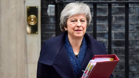Theresa May, U.K. prime minister, departs number 10 Downing Street on her way to a weekly questions and answers session at Parliament in London, U.K., on Wednesday, Dec. 12, 2018.