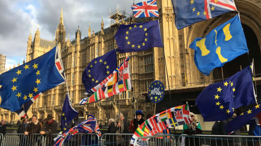 Pro-EU supporters outside the British Parliament buildings in London on Dec. 12, 2018.