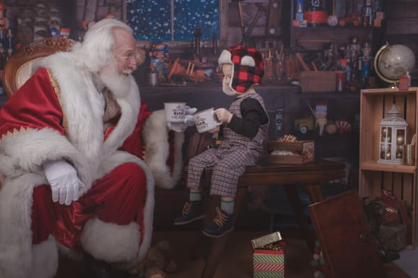 Santa Rick with young boy in a photo session.