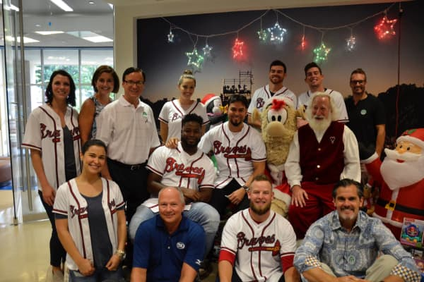 Santa Rick with members of the Atlanta Braves baseball team visiting the Scottish Rite Children's Medical Center in July 2018.