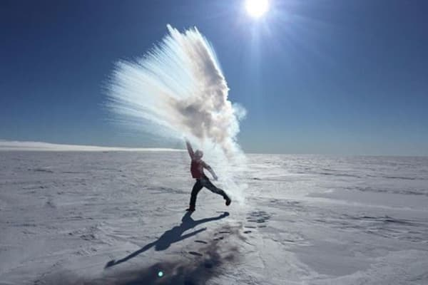 """Colin O'Brady throws a pot of boiling water into the air in the Antarctic, creating """"Antarctica Fireworks."""""""