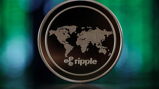 In this photo illustration of the ripple cryptocurrency 'altcoin' sits arranged for a photograph on April 25, 2018 in London, England.