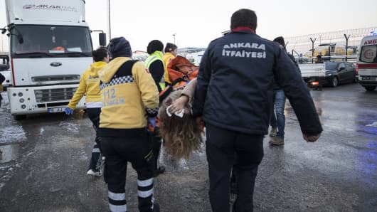 Rescue workers evacuate injured passengers after high-speed train crashed in Turkish capital Ankara on December 13, 2018.