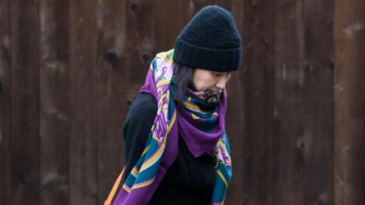 Meng Wanzhou, chief financial officer of Huawei Technologies Co., leaves her home under the supervision of security in Vancouver, British Columbia, Canada, on Wednesday, Dec. 12, 2018.