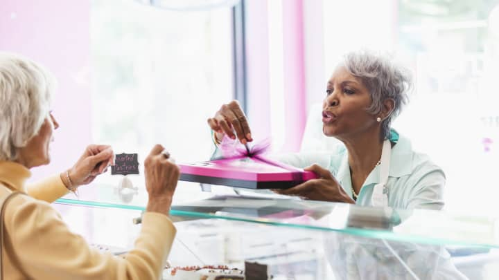 Senior African-American woman, customer in pastry shop