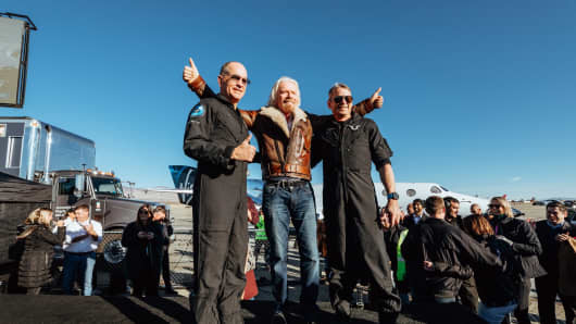 Virgin Group founder and billionaire Richard Branson with Virgin Galactic's first two astronauts.