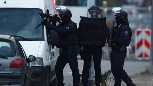 French special police forces secure an area during a police operation in the Meinau district after the deadly shooting in Strasbourg, France, December 13, 2018.