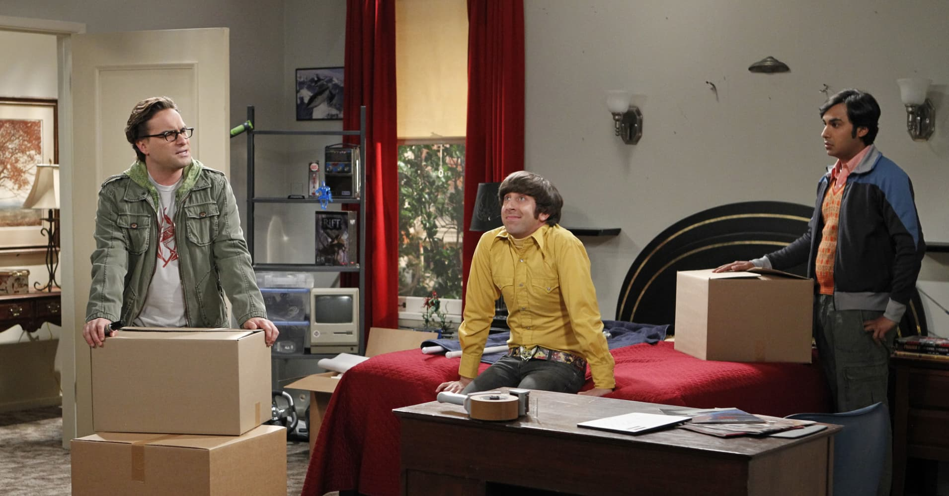 Howard Wolowitz (center) struggles with moving out of his mother's house, on The Big Bang Theory.